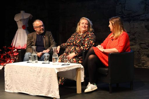Rick O'Shea interviews Authors of Oh My God, What a Complete Aisling series Sarah Breen and Emer McLysaght at Dublin Book Festival 2019. Image is of three individuals in discussion while seated at a table on a stage.